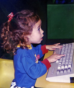 Kaitlyn on computer at age 3